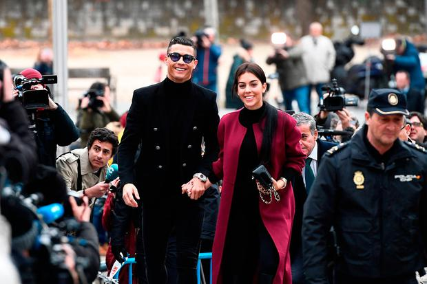 Cristiano Ronaldo arrives with his Spanish girlfriend Georgina Rodriguez to attend a court hearing for tax evasion in Madrid on January 22, 2019