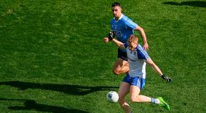 RIVALS: Monaghan's Kieran Hughes in action against Dublin's James McCarthy during their Allianz FL Division 1 clash at Croke Park last March. Photo: Ray McManus/Sportsfile