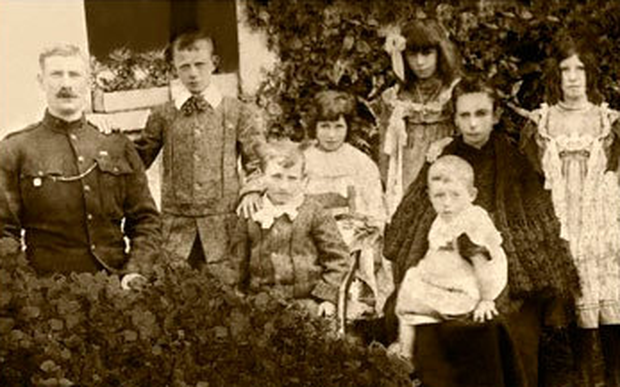Not forgotten: Constable James McDonnell with his young family in a photo taken after the turn of the 20th century. Inset below, a plaque marks the scene of the Soloheadbeg abmush. Photo: thurles.info