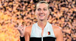 Petra Kvitova celebrates her victory against Ashleigh Barty during their women's singles quarter-final match on day nine of the Australian Open in Melbourne. Photo: AFP/Getty Images