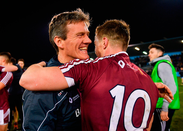 Westmeath manager Jack Cooney, here congratulating Ger Egan last Friday night, will be hoping his team can build on their O'Byrne Cup success in the league. Photo: Piaras Ó Mídheach/Sportsfile