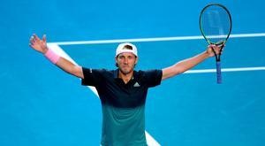 France's Lucas Pouille celebrates after winning the match against Canada's Milos Raonic. REUTERS/Lucy Nicholson