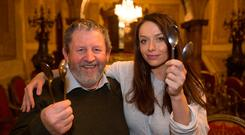Trad musician Tommy Hayes of Stockton's Wing teaches Katie Byrne how to play the spoons. Pic:Mark Condren 4.1.2019