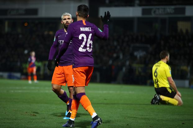BURTON-UPON-TRENT, ENGLAND - JANUARY 23: Sergio Aguero of Manchester City celebrates with Riyad Mahrez of Manchester City after scoring their team's first goal during the Carabao Cup Semi Final Second Leg match between Burton Albion and Manchester City at Pirelli Stadium on January 23, 2019 in Burton-upon-Trent, United Kingdom. (Photo by Mark Thompson/Getty Images)