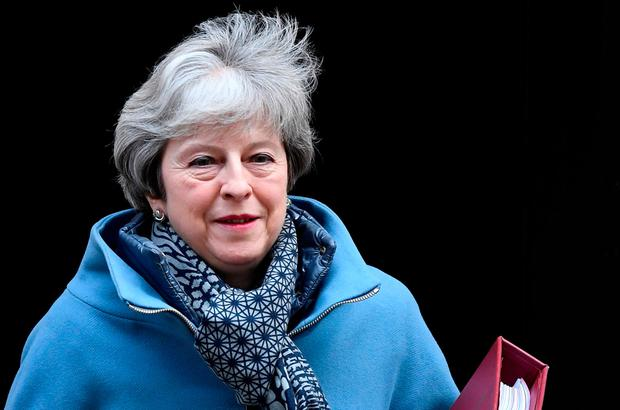 "Theresa May continued her remake of 'Weekend At Bernie's' by sticking the ""No £65 fee for EU nationals"" shawl on the corpse to convince the mob it's alive. Photo: REUTERS/Toby Melville"