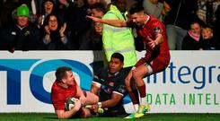 Chris Farrell, supported by Conor Murray, celebrates after scoring a try for Munster despite the efforts of Senitiki Nayalo, one of Edinburgh's six Kolpak players. Photo: Diarmuid Greene/Sportsfile