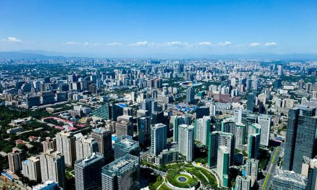 """Betting big: Sunac is deepening its investment in housing in Bejing (pictured) and Shanghai — even as China enters a predicted """"year of recession"""""""