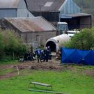 Gardaí examine the slurry tank where the body of Bobby Ryan was found in Fawnagown, Co Tipperary. Picture: Brian Gavin/Press 22