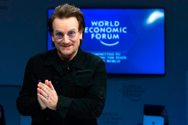 Money talks: Bono joins a panel session at the World Economic Forum in Davos, Switzerland.