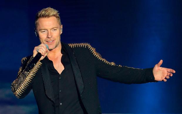 Ronan Keating of Boyzone on stage at the SSE Arena, Belfast, as part of the band's Thank You & Goodnight farewell tour. Niall Carson/PA Wire