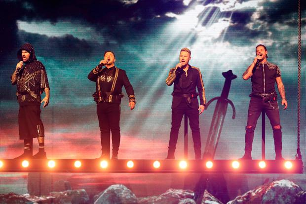 Shane Lynch, Mikey Graham, Ronan Keating and Keith Duffy of Boyzone on stage at the SSE Arena, Belfast, as part of the band's Thank You & Goodnight farewell tour. Niall Carson/PA Wire