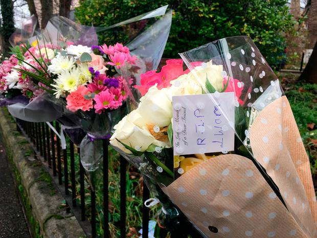 Flowers which have been left at the scene in Forest Road, east London, where a 21-year-old woman has died after being hit by a police car responding to a 999 call. Jasmine Cameron-Chileshe /PA Wire