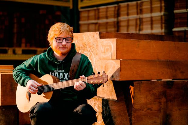 Ed Sheeran as he announced a new collaboration with Co Down company Lowden Guitars, aimed at making quality good value guitars to encourage more young people to play music. Bradley Quinn/Lowden Guitars/PA Wire