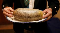 A Haggis is carried at a Burns supper in Killiecrankie, Scotland January 25, 2014. REUTERS/Russell Cheyne/File Photo
