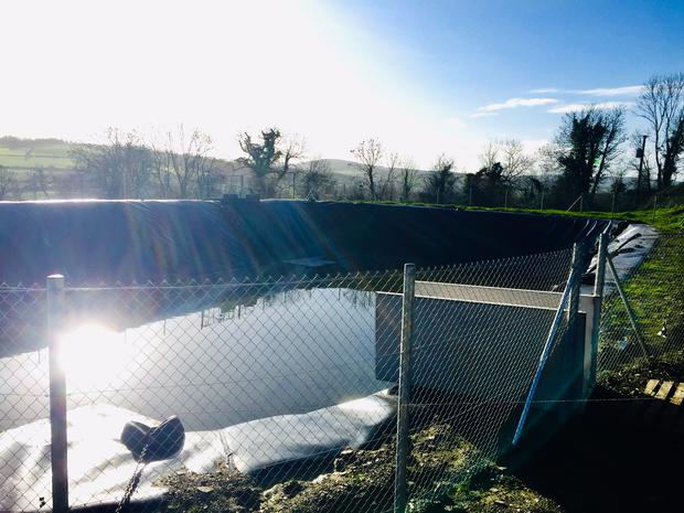 The new 1m gallon lagoon on the farm.