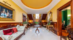 Dramatic: The oval tray ceiling and split staircase