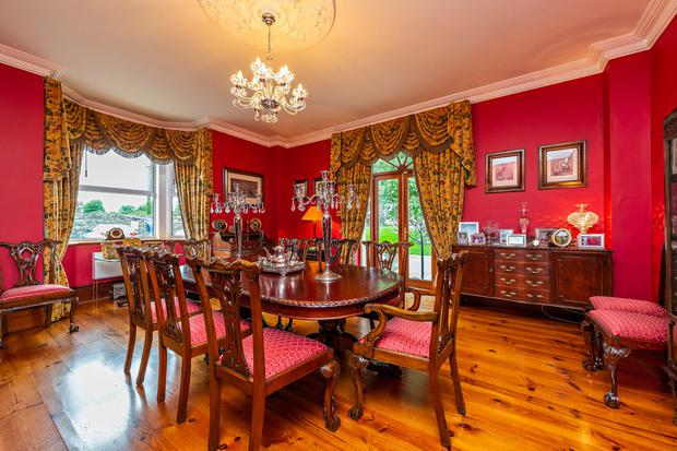 The red painted dining room