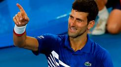 Novak Djokovic reacts after winning his match against Lucas Pouille