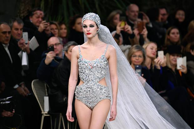 Italian model Vittoria Ceretti presents a creation by Chanel during the 2019 Spring-Summer Haute Couture collection fashion show at the Grand Palais in Paris, on January 22, 2019. (Photo by Anne-Christine POUJOULAT / AFP)