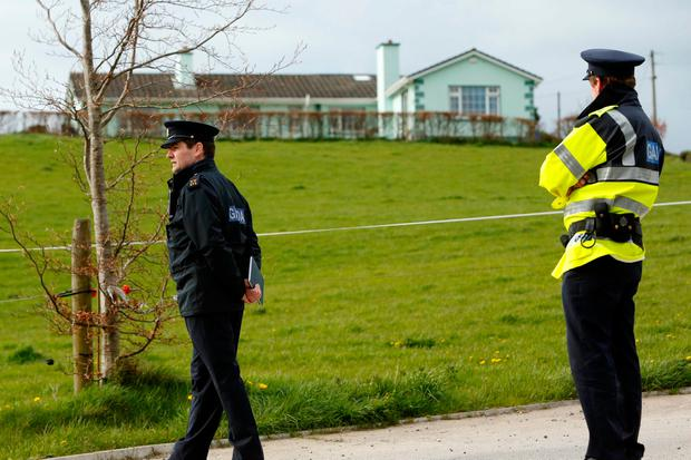 Cordon: Gardaí at the house in 2013 where the body of Bobby Ryan was found. Photo: Don Moloney/Press 22