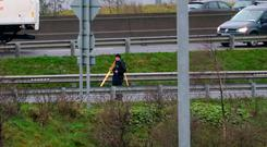 Tragic: A garda examines the scene of the fatal collision at the northbound Finglas interchange of the M50. Photo: Collins