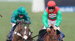 Adjali and Daryl Jacob (left) make Quel Destin pull out all the stops in the Finale Hurdle at Chepstow last month – the pair can go one better at Cheltenham today. Photo: Alan Crowhurst/Getty Images