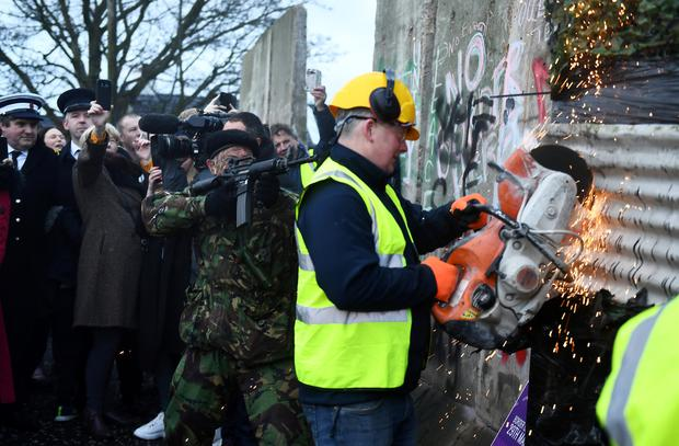 A mock border wall is being destroyed during a protest by anti-Brexit campaigners, Borders Against Brexit in Carrickcarnan, Ireland, January 26, 2019. REUTERS/Clodagh Kilcoyne