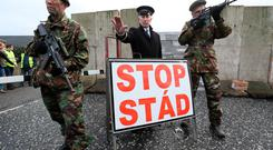 A mock checkpoint manned by actors dressed as soldiers and customs officers constructed during an anti-Brexit rally at the Irish border near Carrickcarnan, Co Louth. PRESS ASSOCIATION Photo. Picture date: Saturday January 26, 2019. Hundreds of protesters have warned Theresa May that a hard Irish border risks destroying Northern Ireland's hard-won peace. See PA story POLITICS Brexit Border. Photo credit should read: Brian Lawless/PA Wire