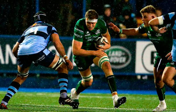 James Cannon of Connacht is tackled by George Earle of Cardiff Blues during the Guinness PRO14 Round 14 match between Cardiff Blues and Connacht at Cardiff Arms Park. Photo by Chris Fairweather/Sportsfile