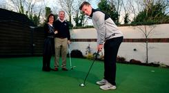 Conor Purcell (above) practises at home as parents Joey and Mary look on. Photo: Mark Condren