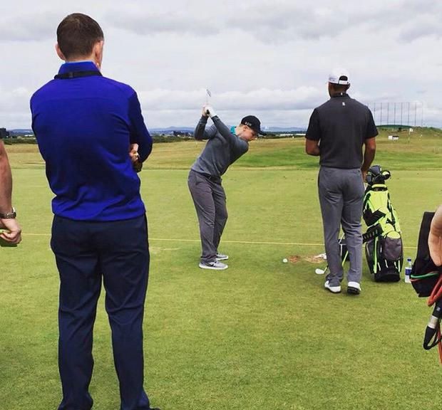 Purcell preparing to take a shot in the company of Tiger Woods at St Andrews