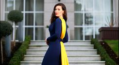 Showstopping: Fashion designer Laura Jayne Halton shows off her navy and gold creation. Photo: David Conachy