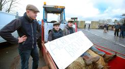 BORDER STAND: Farmers Brendan McLaughlin, Shane McNally and Ryan Gallagher at the protest. Photo: Jonathan Porter