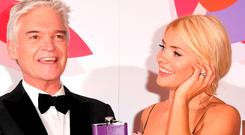 NOT HIP: Phillip Schofield, with hip flask, and Holly Willoughby at the awards. Picture: Getty