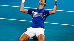 Serbia's Novak Djokovic reacts after beating Rafael Nadal
