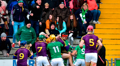Wexford and Limerick players tussle