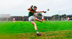 Kerry's Sean O'Shea kicks a late point from a sideline in Killarney. Photo by Stephen McCarthy/Sportsfile