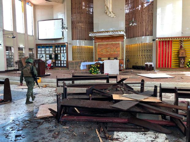 A soldier inside the church after the bomb attack in Jolo, the Philippines. Photo: Reuters