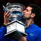 Seventh heaven: Novak Djokovic celebrating with the Australian Open trophy which he also won in 2008, 2011, 2012, 2013, 2015 and 2016. Photo: Getty Images