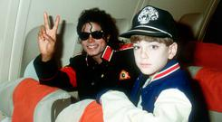 Michael Jackson and James Safechuck, then aged 10, in 1988 on Jackson's private plane. Photo: Dave Hogan/Getty Images