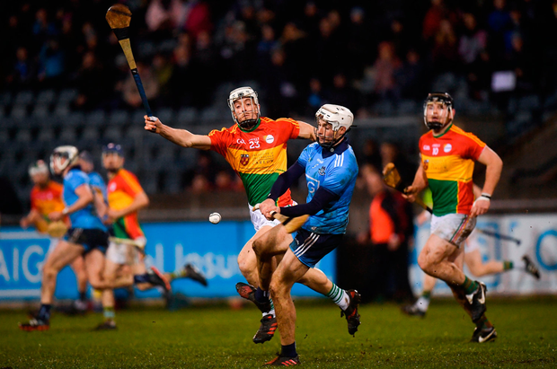 Darragh O'Connell of Dublin in action against James Doyle of Carlow. Photo by Harry Murphy/Sportsfile
