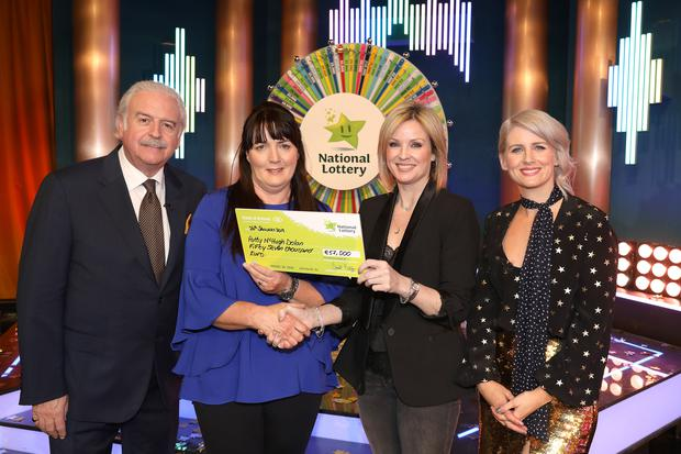Patty McHugh Dolan from Streamstown, Co. Westmeath won €57,000 on last Saturday's National Lottery Winning Streak Game Show on RTE. Marty Whelan, Winning Streak game show co-host; Patty McHugh Dolan, Orla Roche, Head of I Lottery and Sinead Kennedy, Winning Streak game show co-host. Pic: Mac Innes Photography