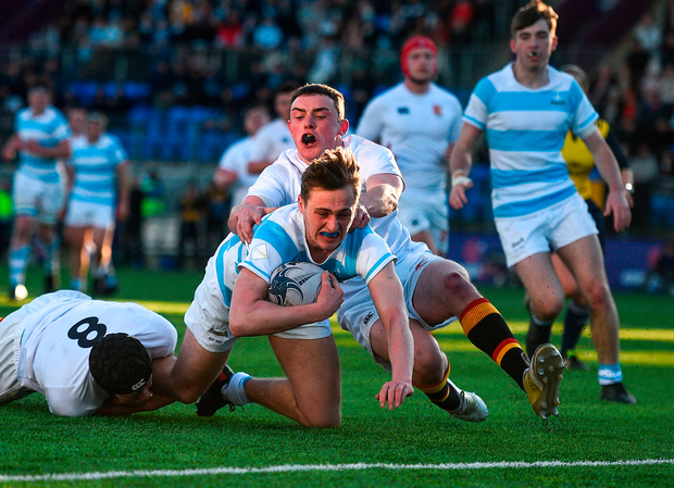 Sam Small scores Blackrock's second try despite the attentions of Pres Bray's Christopher Lawless and Callum McNulty. Photo: David Fitzgerald/Sportsfile
