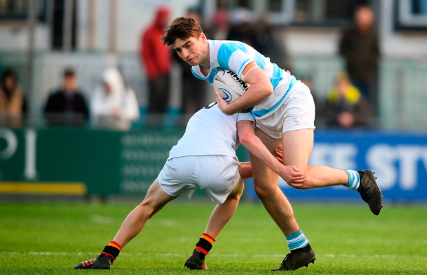 Blackrock's Chris Rolland is tackled by Stephen Corry of Presentation College Bray. Photo: David Fitzgerald/Sportsfile