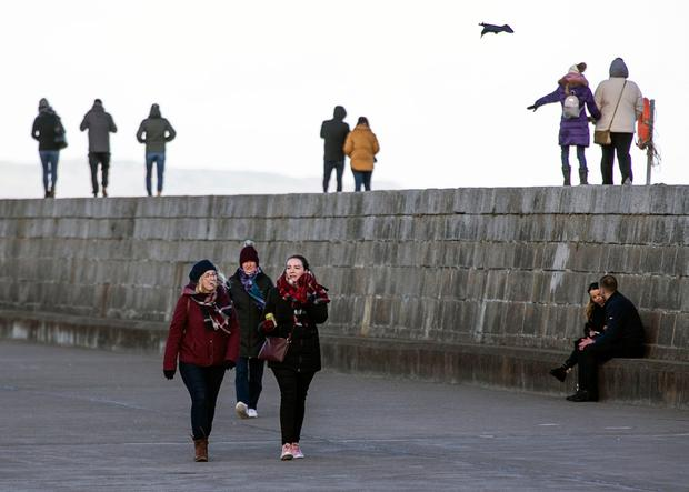 Walkers wrapped up for the sharp crisp morning on Howth Harbour (Photo: Kyran O'Brien)