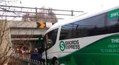 The scene after a bus collided with a bridge at Blakestown in Mulhuddart.