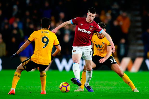Declan Rice of West Ham United is challenged by Leander Dendoncker of Wolverhampton Wanderers and Raul Jimenez of Wolverhampton Wanderers during the Premier League match between Wolverhampton Wanderers and West Ham United at Molineux on January 29, 2019 in Wolverhampton, United Kingdom. (Photo by Michael Steele/Getty Images)
