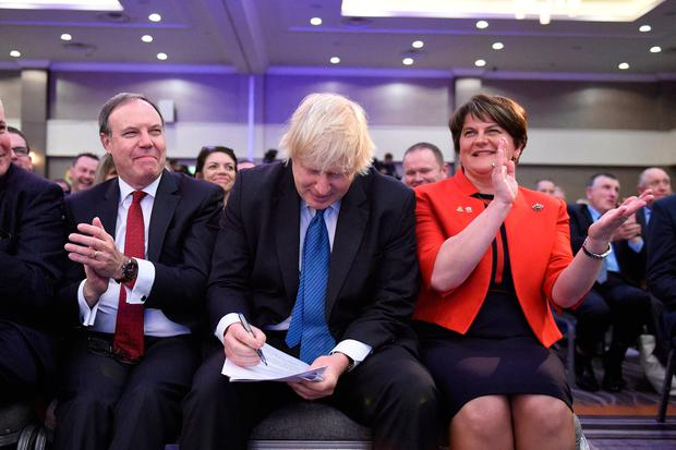 Reckless: DUP deputy leader Nigel Dodds, Tory MP Boris Johnson and DUP leader Arlene Foster at the DUP annual conference in Belfast in November. Photo: PA