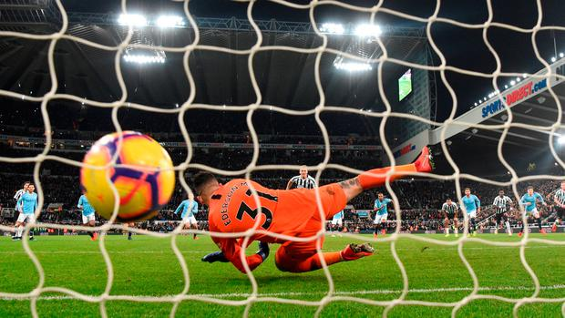 Manchester City Goalkeeper Ederson is unable to stop Matt Ritchie from the penalty spot. Photo: Stu Forster/Getty Images