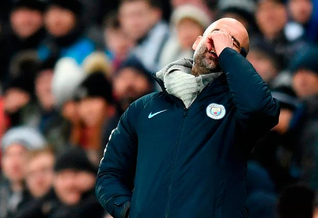 Pep Guardiola shows his frustration during Manchester City's shock 2-1 defeat against Newcastle last night. Photo: Michael Regan/Getty Images